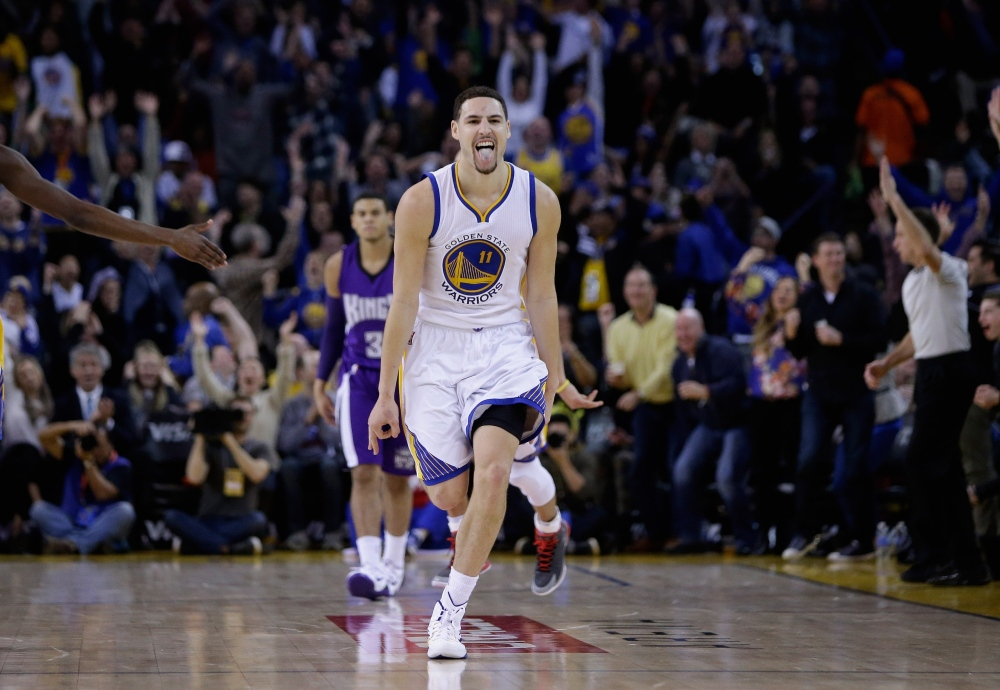 OAKLAND, CA - JANUARY 23:  Klay Thompson #11 of the Golden State Warriors reacts after he made a three-point basket in the third quarter of their game against the Sacramento Kings at ORACLE Arena on January 23, 2015 in Oakland, California. Thompson scored 37 points in the third quarter to set a NBA record. NOTE TO USER: User expressly acknowledges and agrees that, by downloading and or using this photograph, User is consenting to the terms and conditions of the Getty Images License Agreement.  (Photo by Ezra Shaw/Getty Images)