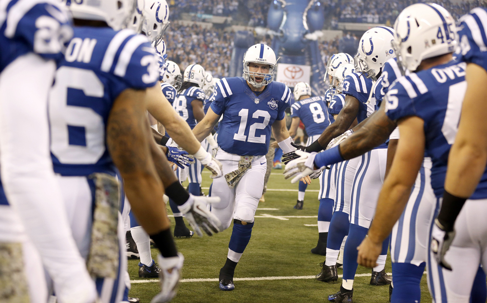 Indianapolis Colts quarterback Andrew Luck (12) heads onto the field before the game. The Rams beat the Colts 38-8 on Sunday, Nov. 10, 2013, in Indianapolis. (Sam Riche/MCT)