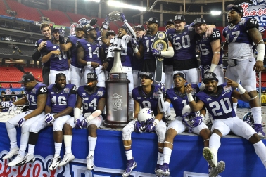 TCU Football vs Ole Miss in the 2014 Chick-fil-A Peach Bowl Played in the Georgia Dome in Atlanta, Georgia on December 31, 2014. Photos by Michael Clements.