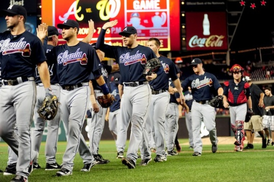 Aug 6, 2013; Washington, DC, USA; Atlanta Braves first baseman Freddie Freeman (center) high fives teammates after beating the Washington Nationals 2-1 at Nationals Park. Mandatory Credit: Evan Habeeb-USA TODAY Sports